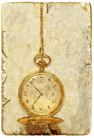 Vintage image of old golden pocket watch photo