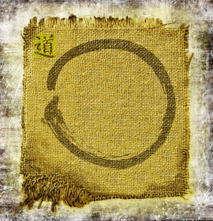 Zen circle on frayed jute. With ideogram Dao, the method. Stock Photo