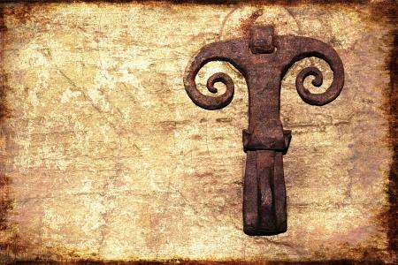 back gate: Ancient rusty iron door knocker