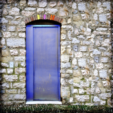 Aluminium door in medieval wall. Coexistence of old and new.