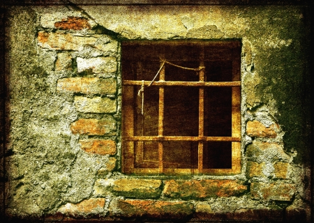 Old and damaged stone wall with window Stock Photo