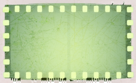 Grunge green film strip frame photo