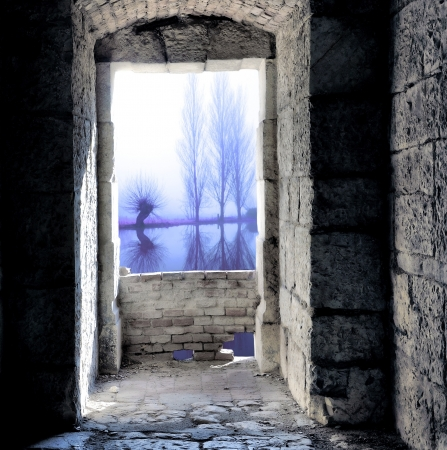 Medieval window with cold light view photo