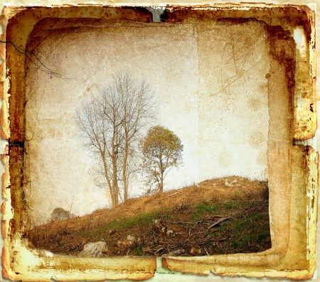 Vintage rural landscape on old paper photo