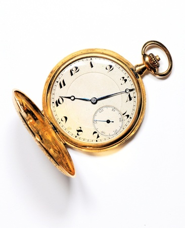 hands in pockets: Old golden pocket watch on white background