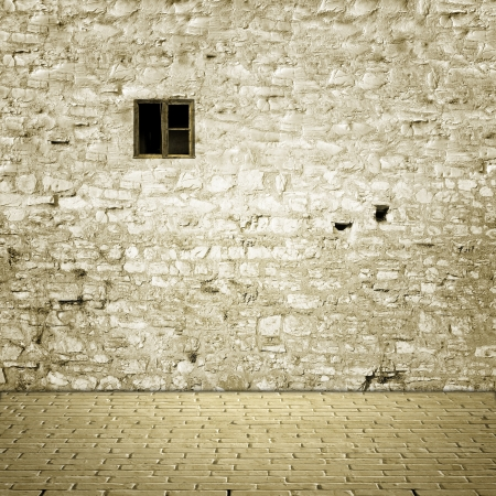 studio backdrop: Floor and stone wall with small wooden window Stock Photo