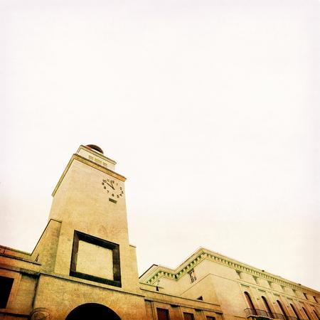 architectural lighting design: Clock tower in Brescia, Italy. Italian architecture of the 30s. Stock Photo
