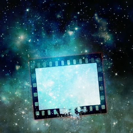 grunge shape: Vintage film strip frame on starry sky Stock Photo