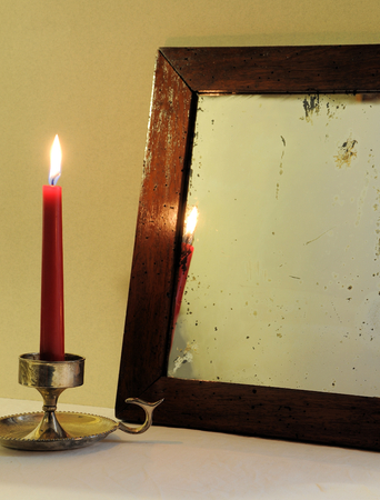 antique mirror: Red candle and antique mirror