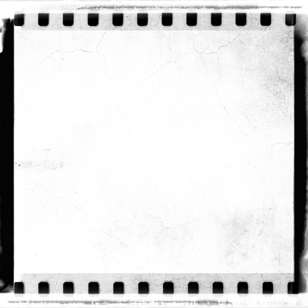 Grunge White Film Strip Frame With Cracked. Stock Photo, Picture And ...