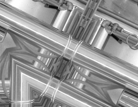 Black and white aluminum background. Metal pipes and abstract technological components. Industrial concept.