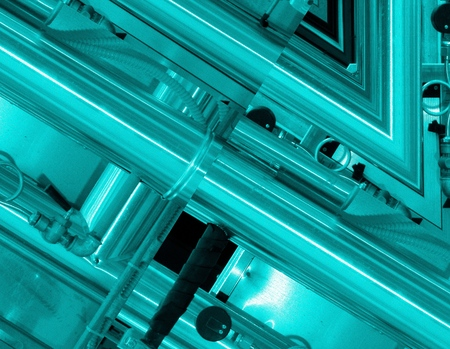 Blue aluminum background. Metal pipes and abstract technological components. industrial concept. Archivio Fotografico