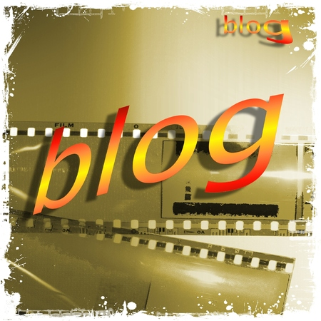 blog word written in yellow and red on empty film strip.