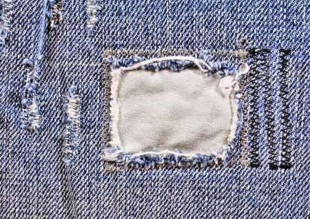 frayed: Frayed blue jeans closeup Stock Photo