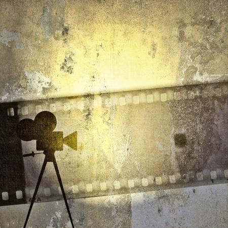 Vintage film strip background and old cinecamera Archivio Fotografico