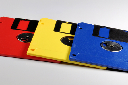 Old color floppy disk. Red, yellow and blue. Archivio Fotografico