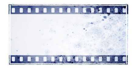 Vintage blue film strip frame with mossy wall surface