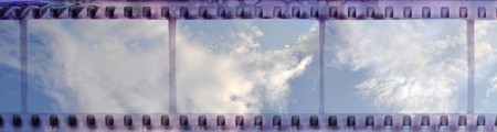 Vintage film strip frame with clear cloudy sky Archivio Fotografico