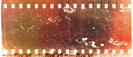 Grunge scratched red film strip frame. Design element.