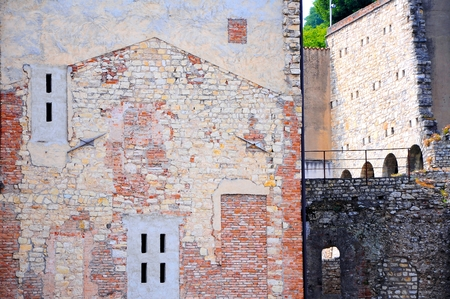 Old medieval house with crumbling facade of building.