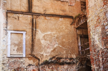 Facade of ancient ruined building. Stock Photo