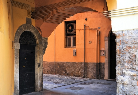 Medieval alley with arched passage. Brescia, Italy.