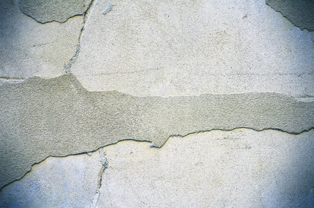 Damaged and peeled cement wall surface. Light blue tones. Useful for texture or background.
