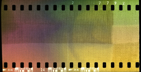 Colorful film strip frame with textured fabric