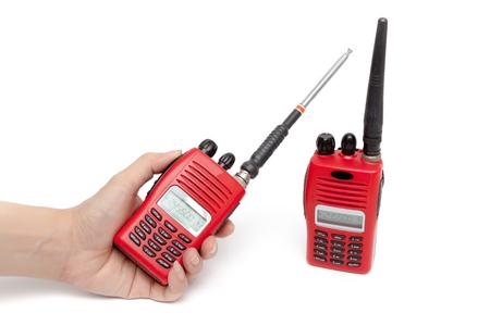 transmit: Portable radio transceiver on white background.