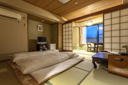 YUFUIN, OITA, JAPAN - MARCH 13, 2017 :  Traditional Japanese guests room of Ryokan Jonoyu, onsen ryokan of yufu city, just 4 mins walk from Yufuin railway station.