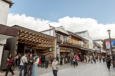 DAZAIFU, FUKUOKA, JAPAN - MARCH 15, 2017 :Starbucks Coffee at Dazaifu use over 2000 wooden batons line the interior of the shop for unique and make a structure that harmonizes with such townscape.