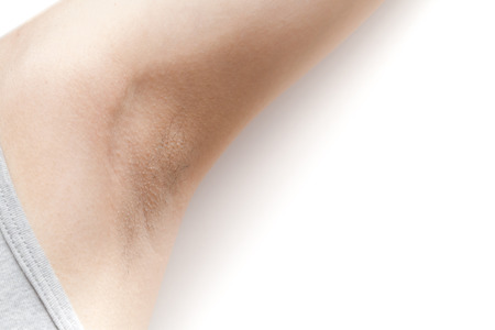 Woman's armpit with some hairy on white background isolated
