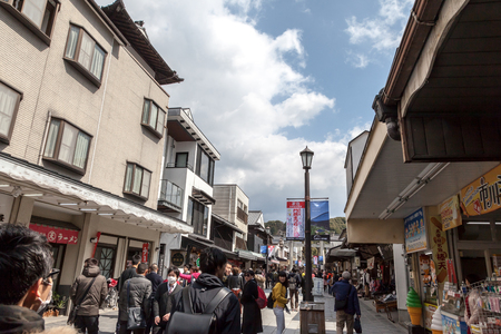 FUKUOKA, JAPAN - MARCH 15, 2017 :  Torii Gate of Dazaifu Tenmangu main street, It has many shop for shopping and eating in Fukuoka prefecture, Japan. Banque d'images - 115361570