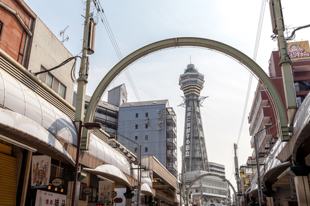 OSAKA, JAPAN - MARCH 19, 2017 :Tsutenkaku Tower is a tower and well-known landmark of Osaka. It is located in the Shinsekai district of Naniwa-ku, Osaka, Japan. Редакционное