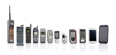 Old Mobile Phone from past to present on white background. Banque d'images - 119136096