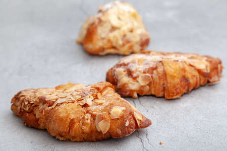 Fresh baked croissants on cement background.