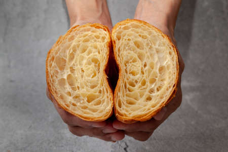 Honeycomb in sliced croissant according to the number of folds on cement background.