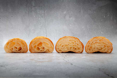 Honeycomb in sliced croissant according to the number of folds on cement background. 版權商用圖片 - 162177933