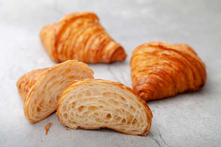 Honeycomb in sliced croissant according to the number of folds on cement background. 版權商用圖片 - 162177513