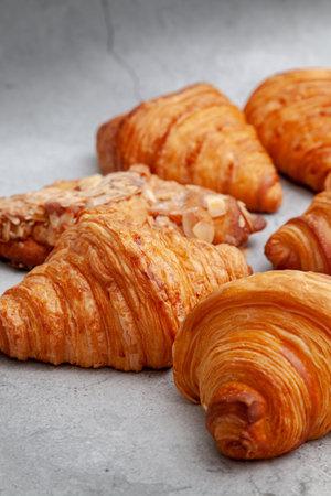 Fresh baked croissants on cement background 版權商用圖片