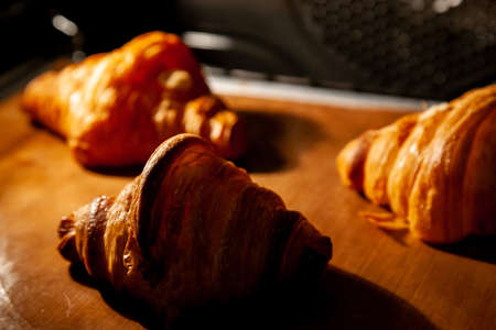 Baking croissants in an oven. 版權商用圖片