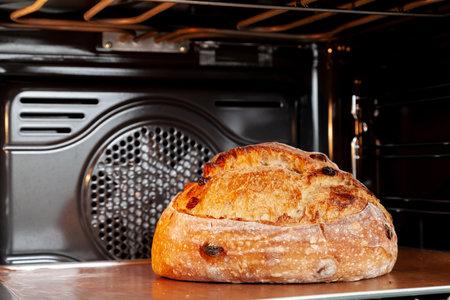 Baking sourdough bread in an oven.