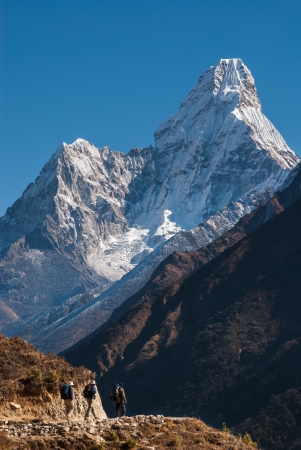 Trekking in Himalayas, with Ama Dablam peak in background, Nepal photo