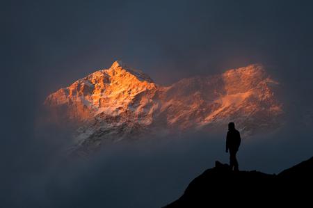 mountain sunset: Silhouette of trekker looking at Makalu massif at sunset Stock Photo