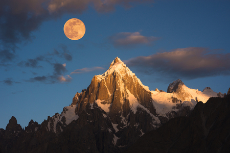 rocky mountain: Morning sunrise over Paiyu peak in Karakoram mountain range of Pakistan Stock Photo
