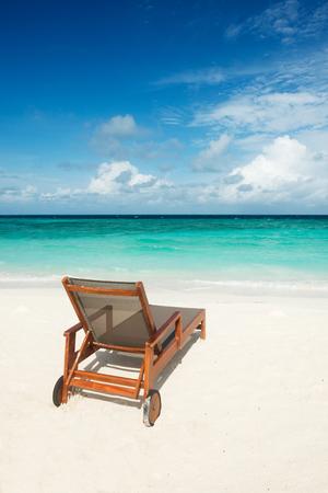 Beach chair on tropical beach of Maldives Imagens
