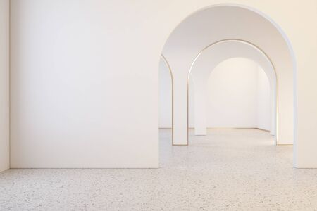 White interior with archs and terrazzo floor.