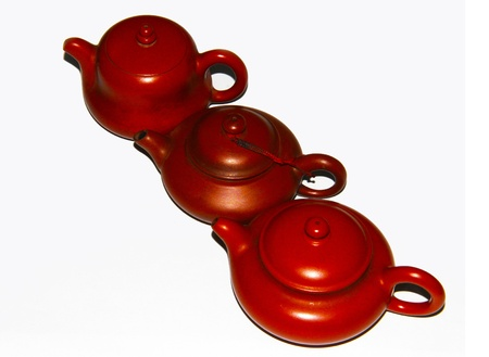 folkways: These are three dark-red enameled pottery