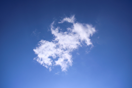 Sapphire blue skies and white clouds Stock Photo
