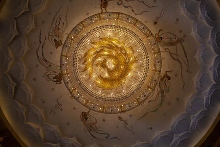 Golden phoenix pattern on large crystal chandelier